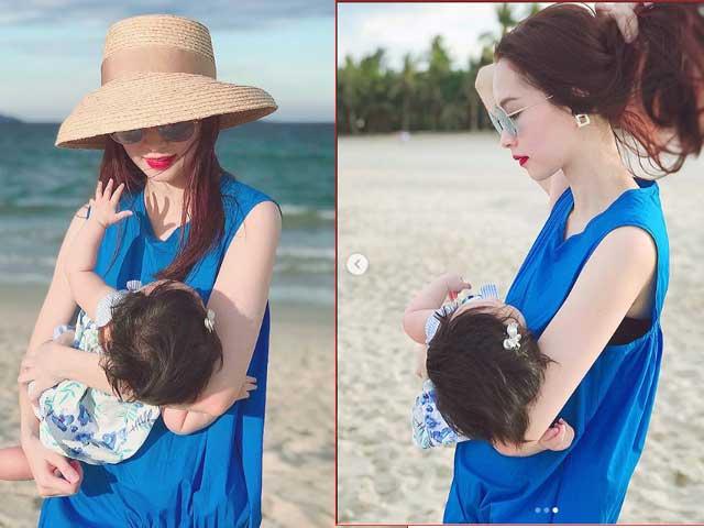 Hoa hậu Đặng Thu Thảo xinh đẹp tuyệt trần, vui đùa với con gái 6 tháng tuổi trên bãi biển