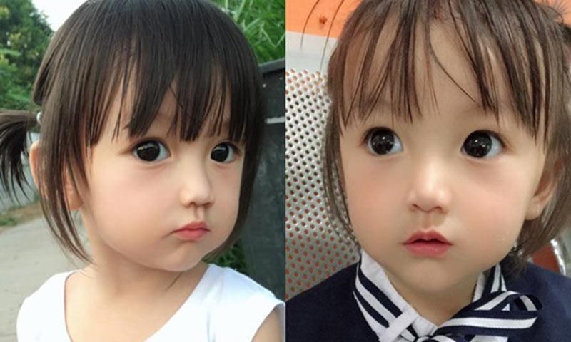 """Thời gian gần đây, mạng xã hội Việt rần rần chia sẻ ảnh của một bé gái cùng lời khen ngợi """"búp bê sống""""."""