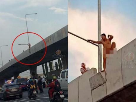 Khỏa thân đứng trên cầu đòi nhảy tự tử, nam thanh niên làm cả phố náo loạn